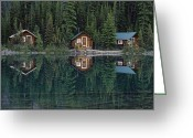 Log Cabins Photo Greeting Cards - Lake Ohara Lodge Cabins Reflected Greeting Card by Michael Melford