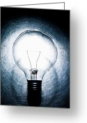 Stainless Steel Greeting Cards - Light Bulb On Stainless Steel Background. Greeting Card by Ballyscanlon
