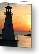 Weathervane Greeting Cards - Lighthouse at sunset Greeting Card by Purcell Pictures