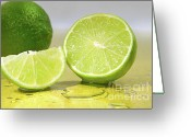 Thirsty Greeting Cards - Limes on yellow surface Greeting Card by Sandra Cunningham