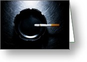 Directly Above Greeting Cards - Lit Cigarette And Ashtray On Stainless Steel. Greeting Card by Ballyscanlon