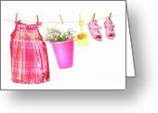 Clothesline Greeting Cards - Little girl clothes and toys on a clothesline Greeting Card by Sandra Cunningham