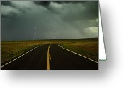 Direction Greeting Cards - Long And Winding Road Against Lighting Strike Greeting Card by DaveArnoldPhoto.com