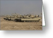 Armored Vehicles Greeting Cards - M1 Abrams Tanks At Camp Warhorse Greeting Card by Terry Moore