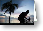 Bike Riding Greeting Cards - Man cycling along the waterfront at sunset Greeting Card by Sami Sarkis