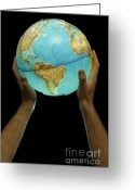 Fingertips Greeting Cards - Man holding illuminated Earth globe Greeting Card by Sami Sarkis