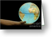 Fingertips Greeting Cards - Man offering illuminated Earth globe Greeting Card by Sami Sarkis