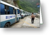 Shaanxi Greeting Cards - Man searching among a row of tourist buses parked on Mount Hua Greeting Card by Sami Sarkis