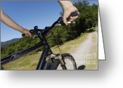 Human Hand Greeting Cards - Man speeding on mountain bike  Greeting Card by Sami Sarkis