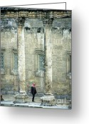 Archaeology Archeological Greeting Cards - Man walking between columns at the Roman Theatre Greeting Card by Sami Sarkis