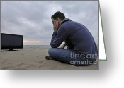 Chin On Hand Greeting Cards - Man with TV on beach at sunset Greeting Card by Sami Sarkis