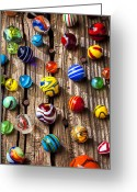Spheres Greeting Cards - Marbles on wooden board Greeting Card by Garry Gay