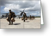 Humanitarian Aid Greeting Cards - Marines Carry Supplies To A Hangar Greeting Card by Stocktrek Images