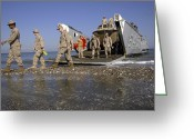 Humanitarian Aid Greeting Cards - Marines Disembark From A Landing Craft Greeting Card by Stocktrek Images