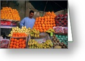 Farmers Markets Greeting Cards - Market vendor selling fruit in a bazaar Greeting Card by Sami Sarkis