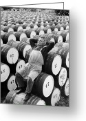 Hands Behind Head Greeting Cards - Mature Man Relaxing On Barrels (b&w) Greeting Card by Hulton Archive