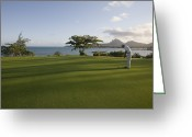 Golf Green Greeting Cards - Men Playing Golf On Le Touessrok Golf Course Greeting Card by Holger Leue