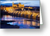 Historical Site Greeting Cards - Mezquita and Roman Bridge in Cordoba Greeting Card by Artur Bogacki