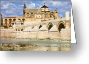 Historical Site Greeting Cards - Mezquita Cathedral and Roman Bridge in Cordoba Greeting Card by Artur Bogacki