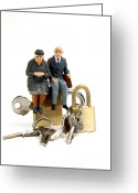 Precaution Greeting Cards - Miniature figurines of elderly couple sitting on padlocks Greeting Card by Bernard Jaubert