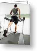 Jogging Greeting Cards - Mixed Race Man Running On Treadmill Greeting Card by Erik Isakson