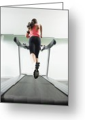 Jogging Greeting Cards - Mixed Race Woman Running On Treadmill Greeting Card by Erik Isakson