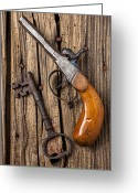 Firearms Photo Greeting Cards - Old pistol and skeleton key Greeting Card by Garry Gay