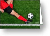 Kicking Football Greeting Cards - Overhead football player sliding Greeting Card by Richard Thomas