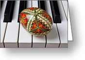 Pianos Greeting Cards - Painted Easter egg on piano keys Greeting Card by Garry Gay