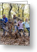 Multicultural Greeting Cards - Parents And Children Playing In A Wood Greeting Card by Ian Boddy