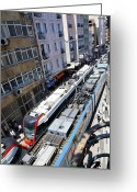 Hustle Bustle Greeting Cards - Passing Trams Below Greeting Card by Kantilal Patel