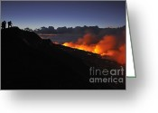 Contemplation Greeting Cards - People watching lava flowing to the sea at sunrise Greeting Card by Sami Sarkis