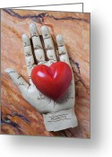 Still Life Greeting Cards - Plam reader hand holding red stone heart Greeting Card by Garry Gay