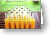 Juice Greeting Cards - Plenty Of Apricot Juice Bottles On Garden Table Greeting Card by Les Hirondelles Photography