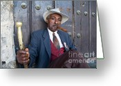 Looking At Camera Greeting Cards - Portrait of a man wearing a 1930s-style suit and smoking a cigar in Havana Greeting Card by Sami Sarkis