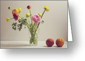 Israel Greeting Cards - Ranunculus Flowers And Red Oranges On White Table Greeting Card by Copyright Anna Nemoy(Xaomena)
