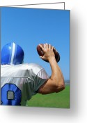 Football Photo Greeting Cards - Rear View Of A Football Player Throwing A Football Greeting Card by Stockbyte