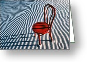 Desert Solitude Greeting Cards - Red chair in sand Greeting Card by Garry Gay