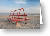 Empty Park Bench Greeting Cards - Red Park Bench on the Beach Greeting Card by Jaak Nilson