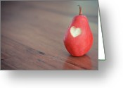 Indoors Photo Greeting Cards - Red Pear With Heart Shape Bit Greeting Card by Danielle Donders - Mothership Photography