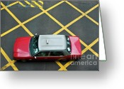 Yellow Line Greeting Cards - Red taxi cab driving over yellow lines in Hong Kong Greeting Card by Sami Sarkis