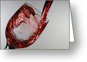 Pouring Greeting Cards - Red wine splashing from a glass cup Greeting Card by Mingqi Ge
