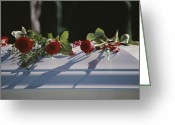 Burials Greeting Cards - Roses Cover The Casket Of An  Officer Greeting Card by Stephen St. John