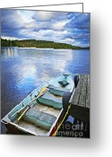 Reflecting Greeting Cards - Rowboat docked on lake Greeting Card by Elena Elisseeva