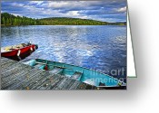 Rowboat Greeting Cards - Rowboats on lake at dusk Greeting Card by Elena Elisseeva