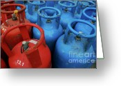 Environmental Damage Greeting Cards - Rows of blue and red domestic gas bottles Greeting Card by Sami Sarkis