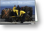 Color Bending Greeting Cards - Sailors Prepare Pallets Of Cargo Aboard Greeting Card by Stocktrek Images