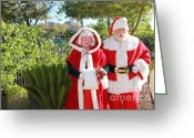 Tropical Golf Course Greeting Cards - Santa and Mrs Claus Greeting Card by Nora Kovach