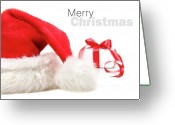 Claus Greeting Cards - Santa hat and gift with red bow Greeting Card by Sandra Cunningham