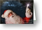 Starry Greeting Cards - Santa pointing with magical light to the sky Greeting Card by Sandra Cunningham